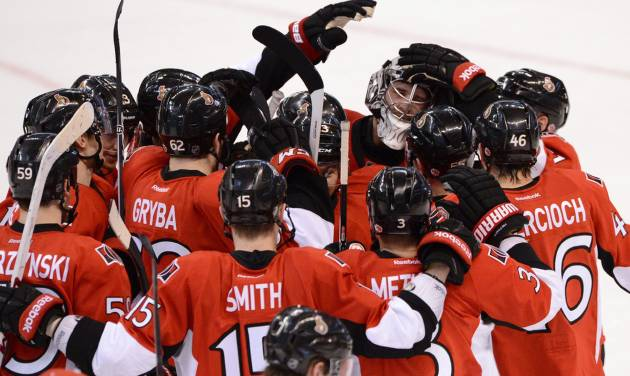 Ottawa Senators goaltender Ben Bishop is congratulated by teammates as they celebrate their 2-1 shootout win against the Montreal Canadiens in their NHL hockey game, Monday, Feb. 25, 2013, in Ottawa, Ontario. (AP Photo/The Canadian Press, Sean Kilpatrick)