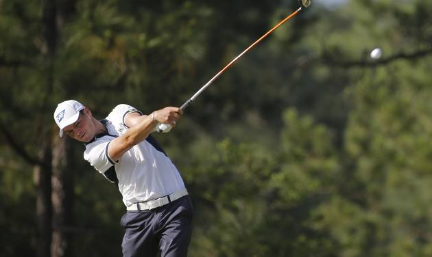 Martin Kaymer, of Germany, watches his tee shot on the 10th hole during the final round of the U.S. Open golf tournament in Pinehurst, N.C., Sunday, June 15, 2014. (AP Photo/Matt York)