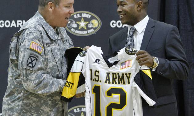 Lt. Gen. Benjamin C. Freakley presents an Army All-American jersey to Barry J. Sanders in 2011. In previous years, Sanders may not have been able to play in the game due to an OSSAA rule. Photo from The Oklahoman Archives