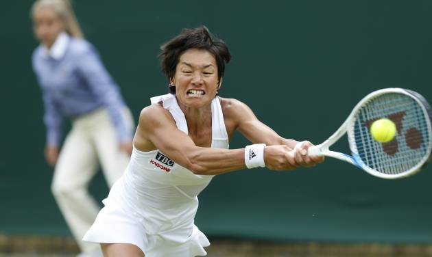 Japan's Kimiko Date-Krumm plays a return to Russia's Ekaterina Makarova during their first round match at the All England Lawn Tennis Championships in Wimbledon, London,  Monday, June  23, 2014. (AP Photo/Ben Curtis)