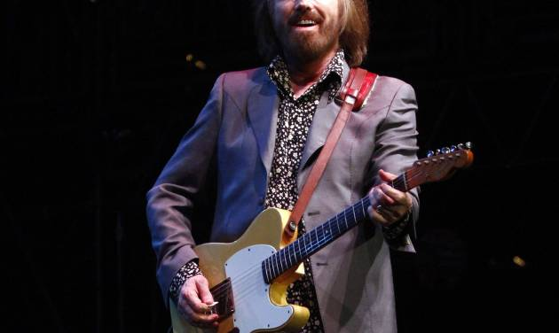 FILE - In this June 16, 2013 file photo, Tom Petty performs on Day 4 of the 2013 Bonnaroo Music and Arts Festival in Manchester, Tenn. Songwriting has gotten harder, not easier, with time, says Petty, who will receive top honors from the American Society of Composers, Authors and Publishers on Wednesday, April 23, 2014, for his four decades in music.  (Photo by Wade Payne/Invision/AP, file)