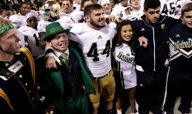 CELEBRATION: Notre Dame linebacker Carlo Calabrese (44) celebrates after the college football game where the University of Oklahoma Sooners (OU) were defeated by the Fighting Irish of Notre Dame (ND) 30-13 at Gaylord Family-Oklahoma Memorial Stadium in Norman, Okla., on Saturday, Oct. 27, 2012. Photo by Steve Sisney, The Oklahoman