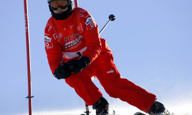 FILE - In this Friday, Jan. 13, 2006 file photo, Ferrari driver Michael Schumacher of Germany speeds down a course in Madonna di Campiglio, Italy. Schumacher is in this Italian Alps ski resort for the yearly meeting between Ferrari drivers and the press.  French radio says retired Formula One champion Michael Schumacher has been injured in a skiing accident.  RMC radio reported Sunday Dec. 29, 2013 that the seven-time champion had fallen while skiing off-piste at the French Alpine resort of Meribel.  The radio quoted resort director Christophe Gernigon-Lecomte as saying that Schumacher was wearing a helmet when he fell and hit a rock. (AP Photo/Luca Bruno, File)