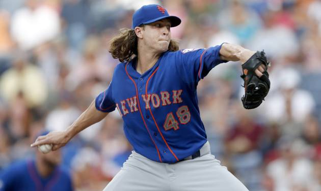New York Mets starting pitcher Jacob deGrom (48) works in the first inning of a baseball game against the Atlanta Braves in Atlanta, Wednesday, July 2, 2014. (AP Photo/John Bazemore)
