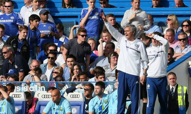 Chelsea manager Jose Mourinho gestures as he watches their English Premier League soccer match against Norwich City at Stamford Bridge stadium in London, Sunday May 4, 2014. (AP Photo/Alastair Grant)