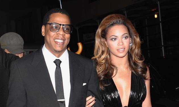 "FILE- In this Dec. 1, 2008 file photo, Hip-hop singer and entrepreneur Jay-Z and his wife singer-actress Beyonce Knowles attend the premiere of ""Cadillac Records"" in New York. The rap mogul put a ring on it in 2008 after six years of unconfirmed dating. They got married in his Manhattan apartment and tried to keep the fancy party under wraps. (AP Photo/Evan Agostini, file)"