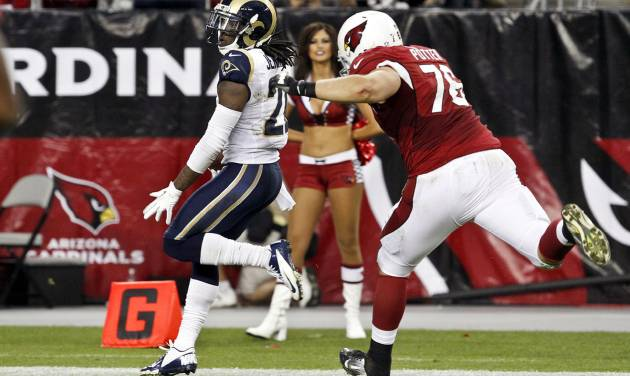 St. Louis Rams' Janoris Jenkins, left, returns an interception for a touchdown as Arizona Cardinals' Nate Potter gives chase during the second half of an NFL football game, Sunday, Nov. 25, 2012, in Glendale, Ariz. The Rams won 31-17. Jenkins became the first player in Rams history and the first NFL rookie since 1960 to return two interceptions for touchdowns in the same game. (AP Photo/Ross D. Franklin)