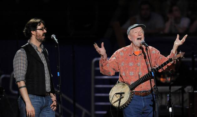 """FILE - In this May 3, 2009 file photo, musician Pete Seeger, right, and grandson Tao Rodríguez-Seeger perform at a benefit concert celebrating Seeger's 90th birthday at Madison Square Garden in New York. A five-day festival honoring the late folk singer will feature music, film and remembrances in New York City and the Hudson Valley. Seeger grandson Kitama Cahill-Jackson says Wednesday, April 30, 2014, the free """"Seeger Fest"""" from July 17 to 21 will celebrate the lives of the famous singer and his late wife, Toshi Seeger.  (AP Photo/Evan Agostini, file)"""