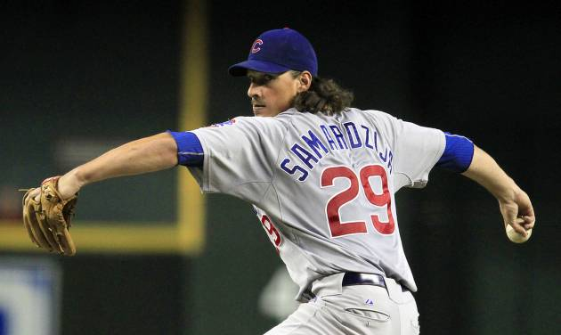 Chicago Cubs' Jeff Samardzija throws against the Arizona Diamondbacks during the third inning in a baseball game on Friday, June 22, 2012, in Phoenix.(AP Photo/Ross D. Franklin)