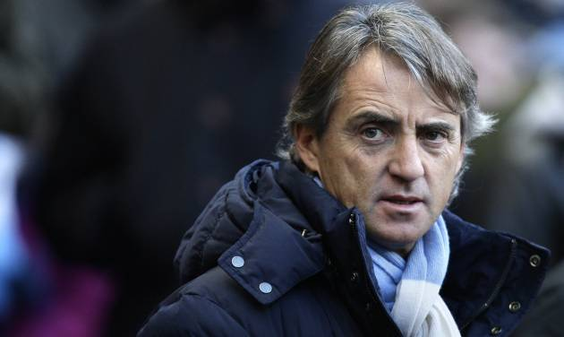 Manchester City's manager Roberto Mancini takes to the touchline before his team's 1-1 draw against Everton during their English Premier League soccer match at The Etihad Stadium, Manchester, England, Saturday, Dec. 1, 2012. (AP Photo/Jon Super)
