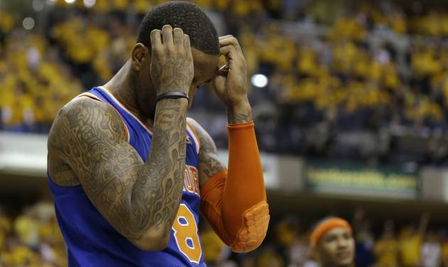 New York Knicks' J.R. Smith reacts late during the second half of Game 6 of an Eastern Conference semifinal NBA basketball playoff series against the Indiana Pacers, Saturday, May 18, 2013, in Indianapolis. Indiana defeated New York 106-99 to win the series 4-2. (AP Photo/Darron Cummings)