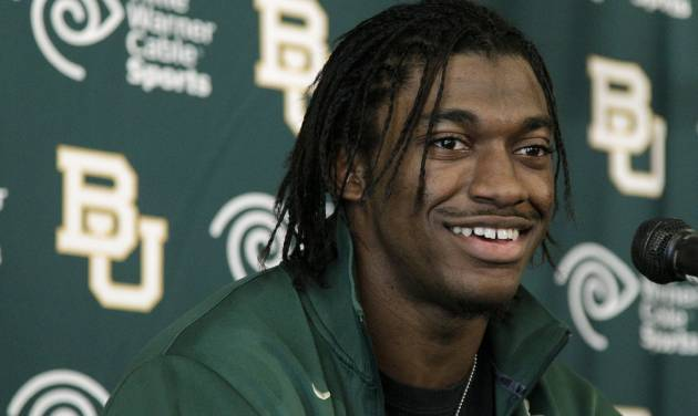 FILE - In this Jan. 11, 2012, file photo, Heisman Trophy winner Robert Griffin III attends a news conference after announcing that he would skip his senior year at Baylor and enter the NFL draft in Waco, Texas. FOXSports.com is reporting the Washington Redskins have a deal in place to acquire the No. 2 pick in the NFL draft and plan to take Griffin. (AP Photo/Tony Gutierrez, File)