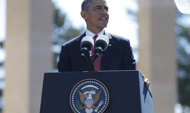 U.S. President Barack Obama  speaks at Normandy American Cemetery at Omaha Beach as he participates in the 70th anniversary of D-Day in Colleville sur Mer in Normandy, France, Friday, June 6, 2014. (AP Photo/Charles Dharapak)
