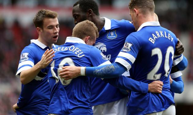 Everton's Gerard Deulofeu, center, celebrates after his shot was turned into the goal by Sunderland's Wes Brown during their English Premier League soccer match at the Stadium of Light, Sunderland, England, Saturday, April 12, 2014. (AP Photo/Scott Heppell)