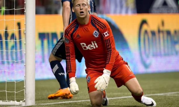 Vancouver Whitecaps goalkeeper David Ousted, of Denmark, reacts after allowing a goal to Portland Timbers' Alvas Powell, of Jamaica, during the second half of an MLS soccer game in Vancouver, British Columbia, on Saturday, Aug. 30, 2014. (AP Photo/The Canadian Press, Darryl Dyck)