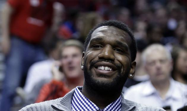 Former Portland Trail Blazers center Greg Oden watches from the crowd during the first quarter of an NBA basketball game between the Trail Blazers and Memphis Grizzlies in Portland, Ore., Wednesday, April 3, 2013.(AP Photo/Don Ryan)