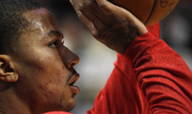 Chicago Bulls point guard Derrick Rose works out before an NBA basketball game against the Utah Jazz, Friday, March 8, 2013, in Chicago. (AP Photo/Charles Rex Arbogast) ORG XMIT: CXA102