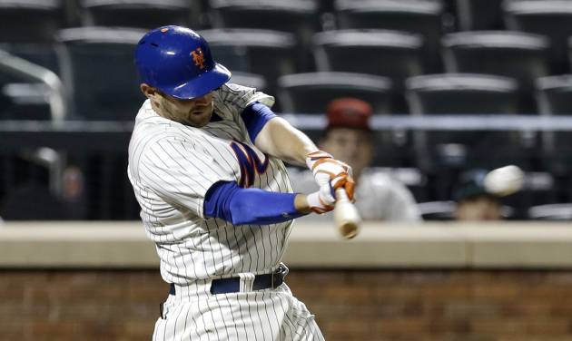 New York Mets' Andrew Brown hits the game winning single during the 13th inning of the baseball game against the Arizona Diamondbacks at Citi Field, Tuesday, July 2, 2013, in New York. The Mets beat the Diamondbacks 5-4. (AP Photo/Seth Wenig)