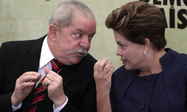Brazil's President Dilma Roussef, right, talks with former President Luiz Inacio Lula da Silva during the installation of the Truth Commission at Planalto presidential palace in Brasilia, Brazil, Wednesday, May 16, 2012. Rousseff has sworn in the seven members of a truth commission created to look into human rights abuses committed during the nation's long dictatorship. (AP Photo/Eraldo Peres)