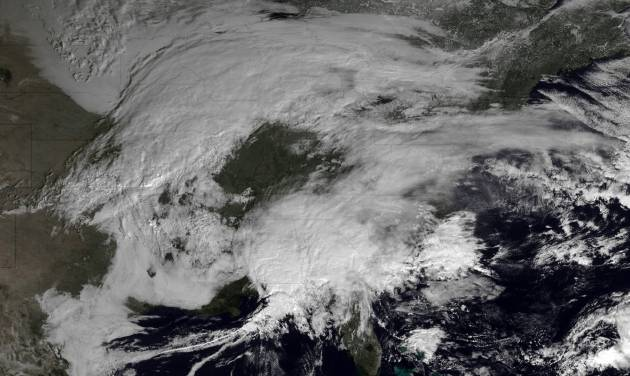 This image made available by NOAA shows storm systems over the eastern half of the United States on Thursday, Feb. 7, 2013 at 11:15 EST. A blizzard of potentially historic proportions threatened to strike the Northeast with a vengeance Friday, Feb. 8, 2013 with 1 to 2 feet of snow feared along the densely populated Interstate 95 corridor from the New York City area to Boston and beyond. (AP Photo/NOAA)