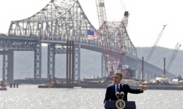 President Barack Obama speaks near the base of the Tappan Zee Bridge, Wednesday, May 14, 2014, in Tarrytown, N.Y. Obama is calling on Congress to pass a $302 billion transportation infrastructure bill that White House officials say would support millions of jobs while repairing the nation's crumbling roads and bridges. White House officials are touting the $3.9 billion Tappan Zee Bridge Replacement Project as a model for an expedited permitting and review process.(AP Photo/Julie Jacobson)