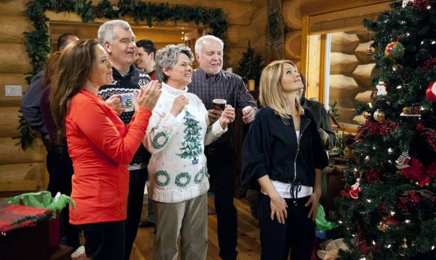 "This image released by Crown Media shows a scene from the Christmas TV movie ""Let it Snow,"" one of the films to air on Hallmark TV channels for a week, beginning on Independence Day.  The stunt on the Hallmark and Hallmark Movie channels  continues into the early morning hours of July 15. Mostly, it will be repeats of the holiday movies that Hallmark traditionally airs during the last two months of the year. (AP Photo/Crown Media)"