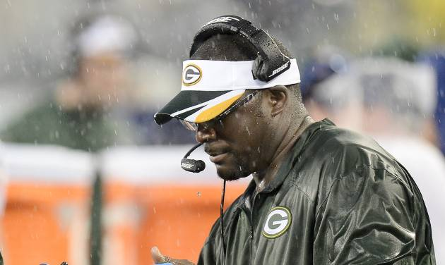 In this Aug. 9, 2014 photo, Green Bay Packers wide receivers coach Edgar Bennett uses a computer pad in a rainstorm during a preseason NFL football game against the Tennessee Titans in Nashville, Tenn. The tablets, designed to survive all sorts of weather, are equipped to look at still photos of game action. (AP Photo/Mark Zaleski)