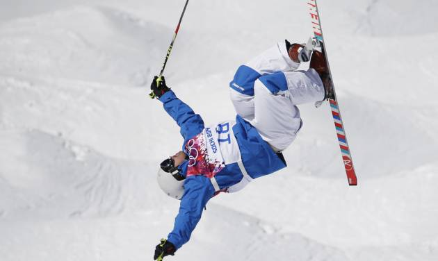 France's Guilbaut Colas jumps during freestyle skiing moguls training at the Rosa Khutor Extreme Park  ahead of the 2014 Winter Olympics, Friday, Feb. 7, 2014, in Krasnaya Polyana, Russia. (AP Photo/Andy Wong)