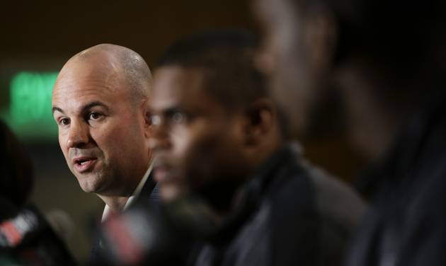 Florida State defensive coordinator Jeremy Pruitt, left, speaks as he is joined by cornerback Lamarcus Joyner, center, and linebacker Telvin Smith during a news conference on Thursday, Jan. 2, 2014, in Newport Beach, Calif. Florida State is scheduled to play Auburn on Monday, Jan. 6, in the BCS national championship NCAA college football game. (AP Photo/Jae C. Hong)
