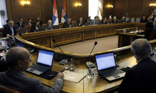 Members of the Serbian government attend a session in Belgrade, Serbia, Monday, April 22, 2013. The Serbian government on Monday approved a potentially landmark agreement to normalize relations with breakaway Kosovo that could end years of tensions and put the Balkan rivals on a path to European Union membership. (AP Photo/ Marko Drobnjakovic)