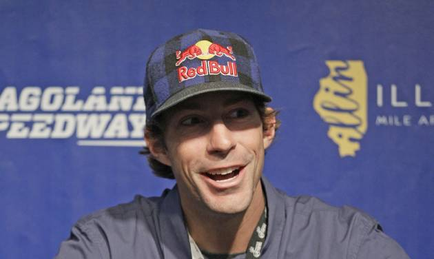 FILE - This July 21, 2012 file photo shows Travis Pastrana smiling as he speaks at a news conference at Chicagoland Speedway in Joliet, Ill. Travis Pastrana is leaving NASCAR after this weekend's season finale Nationwide Series race at Homestead. Pastrana announced his decision Monday, Nov. 11, 2013 on his Facebook page. (AP Photo/Nam Y. Huh, File)