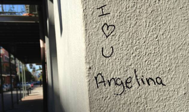 Graffiti outside the New Orleans home of star couple Brad Pitt and Angelina Jolie is pictured on Saturday, Feb. 2, 2013. The city hosts NFL football's Super Bowl XLVII between the San Francisco 49ers and Baltimore Ravens on Sunday. (AP Photo/Nancy Armour)