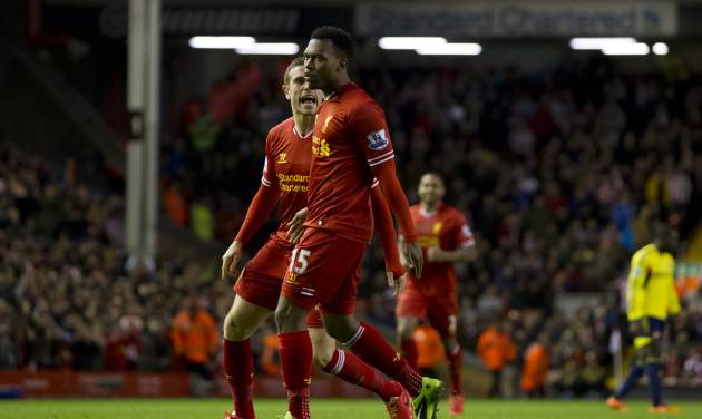 Liverpool's Daniel Sturridge, centre, celebrates with teammate Jordan Henderson after scoring against Sunderland during their English Premier League soccer match at Anfield Stadium, Liverpool, England, Wednesday, March 26, 2014. (AP Photo/Jon Super)