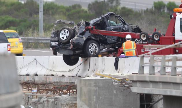 Five people including one child were injured when this Toyota RAV 4 SUV crashed into a construction zone at I-805 at Sorrento Valley Boulevard, April 25, 2012, San Diego, Calif. Construction workers at the scene stabilized the vehicle until firefighters could extricate the passengers. (AP Photo/UT San Diego, John Gibbins) NO SALES, ONLINE OUT, NO ARCHIVING, SAN DIEGO COUNTY OUT, TV OUT, MAGS OUT, NO FORNS. TABLOIDS OUT. WIDE WORLD OUT. COMMERCIAL INTERNET USE OUT.