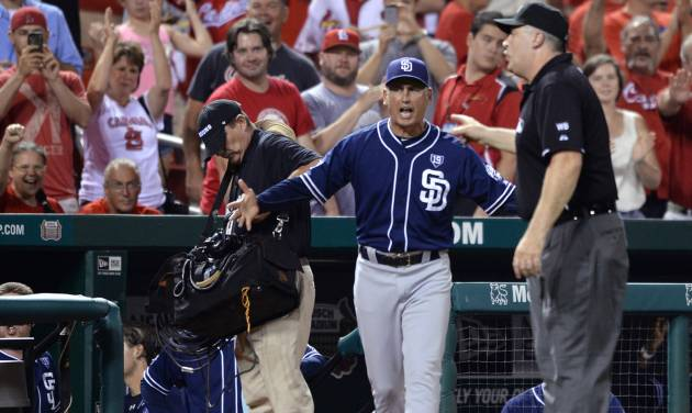 San Diego Padres manager Bud Black, center, is thrown out of the game by umpire Bill Welke, right, after protesting a reviewed call on a play at the plate against the St. Louis Cardinals in the ninth inning of a baseball game, Thursday, Aug. 14, 2014, at Busch Stadium in St. Louis. (AP Photo/Bill Boyce)