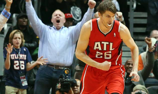 Atlanta Hawks guard Kyle Korver (26) celebrates his 3-pointer that put the Hawks in the lead over the Miami Heat during the second half of an NBA basketball game on Monday, Jan. 20, 2014, in Atlanta. (AP Photo/Atlanta Journal-Constitution, Curtis Compton)