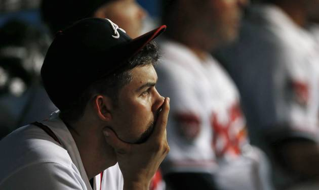 Atlanta Braves starting pitcher Mike Minor (36) sits on the bench after being relieved during their 4-0 loss to the Philadelphia Phillies in a baseball game Tuesday, Sept. 2, 2014, in Atlanta. (AP Photo/John Bazemore)