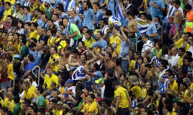 Uruguay's fans cheer during the World Cup round of 16 soccer match between Colombia and Uruguay at the Maracana Stadium in Rio de Janeiro, Brazil, Saturday, June 28, 2014. (AP Photo/Themba Hadebe)