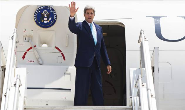 This Aug. 1, 2014, file photo shows Secretary of State John Kerry as he boards a plane to depart New Delhi, India, Secretary of State John Kerry will be focusing on Southeast Asia and the Pacific next week. He'll be leaving Friday on a six-day trip to Myanmar, Australia, the Solomon Islands and Hawaii. (AP Photo/Lucas Jackson, Pool)