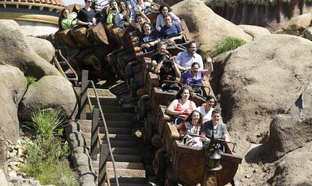 This May 16, 2014 photo shows Disney castmembers testing the new Seven Dwarfs Mine Train roller coaster in the Magic Kingdom at Walt Disney World, in Lake Buena Vista, Fla. The ride will be open to park guests on May 28. (AP Photo/John Raoux)