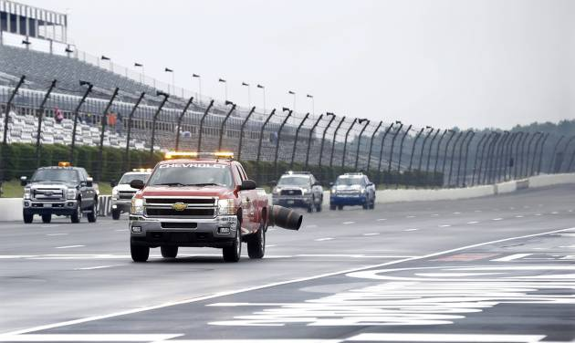 Trucks use jet engines to dry the track following a rainfall Saturday, Aug. 3, 2013, before practice for Sunday's NASCAR Series auto race in Long Pond, Pa. (AP Photo/Mel Evans)