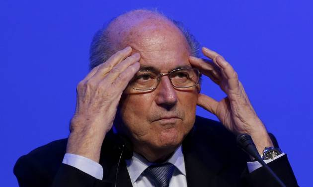 FIFA President Joseph Blatter attends a news conference following the FIFA Congress in Sao Paulo, Brazil, Wednesday, June 11, 2014. Brazil is hosting the 2014 soccer World Cup starting June 12. (AP Photo/Julio Cortez)