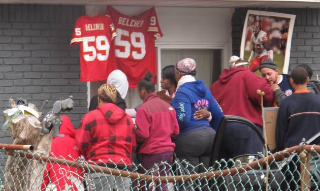 Friends and relatives of Kansas City Chiefs linebacker Jovan Belcher grieve outside the player's home on Dec. 1, 2012, in West Babylon, N.Y. Police said the Long Island native shot and killed his girlfriend before taking his own life on Saturday in Kansas City. (AP Photo/Frank Eltman)