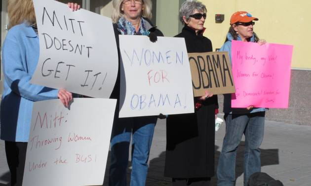 In this Oct. 24, 2012 photo, women backing President Obama protest outside a convention center in Reno where Republican Mitt Romney was giving a campaign speech. Exit polls show significant support from women was a key factor in Obama's victory over Romney in the key battleground state of Nevada. (AP Photo/Scott Sonner)