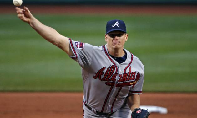 Atlanta Braves starting pitcher Gavin Floyd delivers to the Boston Red Sox in the first inning of a baseball game at Fenway Park in Boston, Wednesday, May 28, 2014. (AP Photo/Elise Amendola)