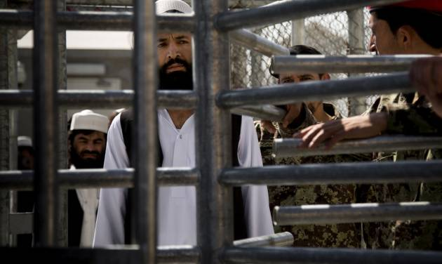 An Afghan prisoner waits in line for his release from Parwan Detention Facility after the U.S. military gave control of its last detention facility to Afghan authorities in Bagram, outside Kabul, Afghanistan, Monday, March 25, 2013. The handover of Parwan Detention Facility ends a bitter chapter in American relations with Afghanistan's mercurial president, Hamid Karzai, who demanded control of the prison as a matter of national sovereignty. (AP Photo/Anja Niedringhaus)