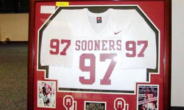 A framed, autographed jersey of former University of Oklahoma defensive lineman Tommie Harris will be auctioned off by the IRS on March 5. PHOTO PROVIDED BY THE IRS