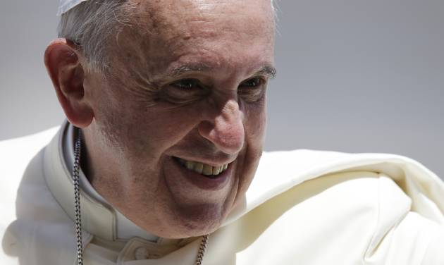 Pope Francis smiles as he leaves St. Peter's Square following his weekly general audience, at the Vatican, Wednesday, June 4, 2014. (AP Photo/Gregorio Borgia)