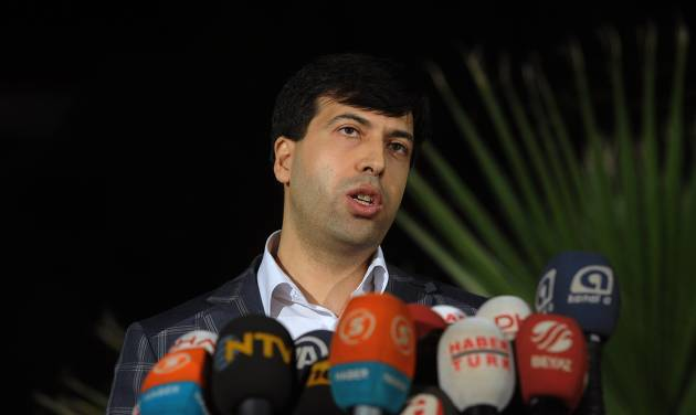Chief prosecutor Bekir Sahiner speaks to the media in the coal miners' town of Soma, Turkey, Sunday, May 18, 2014. Twenty-five people, including mining company executives, have been detained as Turkish officials investigate the mining disaster that killed 301 people, a domestic news agency reported Sunday.(AP Photo/Emre Tazegul)