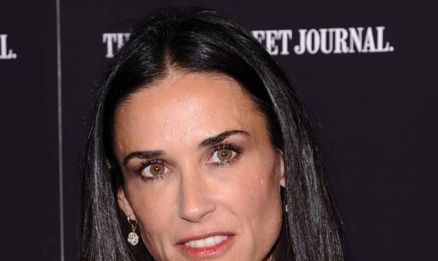"""FILE - In this Oct. 17, 2011 file photo, actress Demi Moore attends the premiere of """"Margin Call"""" in New York. The 49-year old actress changed her Twitter name to @justdemi on Thursday, May 3, 2012. (AP Photo/Peter Kramer, File)"""